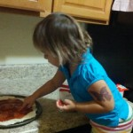 Trying to make pepperoni pizza but she is eating all of the pepperonis